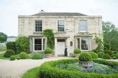 Sarah Howard said: 'The fact the house looks like it has always been there is one of the best compliments.' Pictured: Mrs Howard posing outside her home landhaus Couple pulled manor house apart and rebuilt it in the Cotswolds