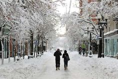 A couple walks down Westminster Street in downtown Providence, R.I., after a winter storm dumped two feet of snow on the area, Saturday, Feb. 9, 2013. (AP Photo/Stew Milne)