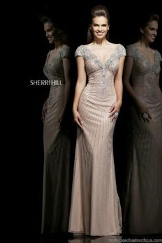 Sherri Hill Cap Sleeves Prom Dress 11103This 2014 Sherri Hill prom dress 11103 is the perfect formal dress to wear to your winter formal or worn as a pageant dress. Style 11103 showcases a brilliant beaded top with cap sleeves, fitted bodice, and floor length skirt. Cascading beadwork embellishes the fitted bodice that shimmers and shines with each movement as you dance under the spotlights. Sophisticated cap sleeves are encrusted in silver beadwork that makes a bold statement.nude