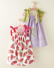 this would be sew easy to do... take one of the pillow case dress and put elastic at them to make a buble dress