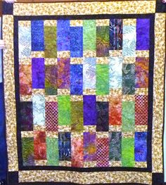 Gorgeous batiks make a great jewel-toned quilt. Sewn by Kay Copenhaver and long armed by Linda Christensen.