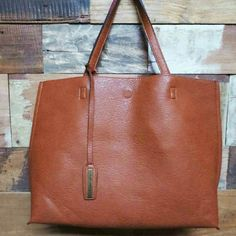 Large brown tote bag Amazing quality,  vegan, look and feels like leather, soft like a glove, comes with dust bag and a small make up bag,  you can fit all  in it, great for traveling,  school, shoping. . The inside color is light coral. Street level  Bags Totes