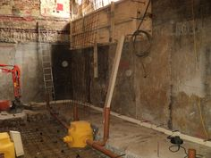 A temporary pump in a basement conversion dig out