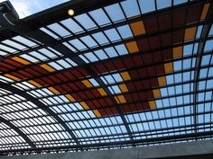 """Roof of new Central Station extension displays """"Amsterdam"""" in coloured glass panels"""