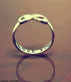 i wouldn't mind something this simple as a wedding ring. ..maaaybe with a small diamond in the center of the infinity symbol :P