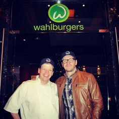 Donnie Wahlberg and brother Paul at the opening of wahlburgers in toronto