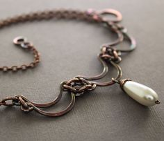 Layered scallop shape copper necklace with white glass pearl drop pendant. $36.00, via Etsy.
