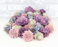 This beautiful dyed sola wood flower assortment is perfect for Valentine's Day! The different shades of purple are sure to be a favorite. Create a beautiful wood flower bouquet, centerpiece, or any other craft project you can think of! #diyflowers #woodflowers #solawood #diycraft #craftideas #diy #preservedflowers