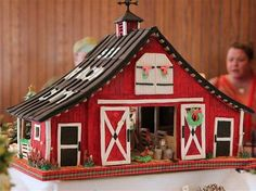 Have a holiday hoedown at this little red barn that's made from gingerbread.