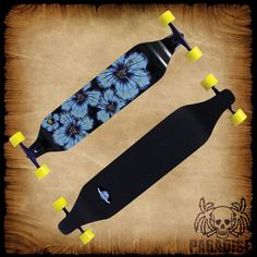 """PARADISE LONGBOARDS """"Tattered Flowers"""" PALB-52 Drop-Down. Comprised of 10 ply's of canadian maple, features concave and measures 8"""" x 40"""". The middle of the deck is lower than where the trucks are mounted which allows for a lower center of gravity thus greater stability at high speeds. The Bigfoot Boho wheels measure 70mm with a 81a hardness and 51mm wide footprint. Complete with high-grade, 181mm downhill aluminum alloy trucks, Abec-7 Speed Bearings, Hardware, & Risers."""
