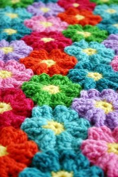 Love this design, and the designer, and the tip she gives to make joining the flower motifs simpler! Waikiki Wildflower Blanket pattern on Craftsy.com