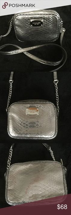 AUTHENTIC MICHAEL KORS MINI CROSS BODY BAG AUTHENTIC MICHAEL KORS Jet Set cross body bag in deep silver/pewter leather with a snakeskin pattern. Silver chain and long leather strap. Very good condition with some wear shown on the corners. Great color, goes with everything! Michael Kors Bags Crossbody Bags