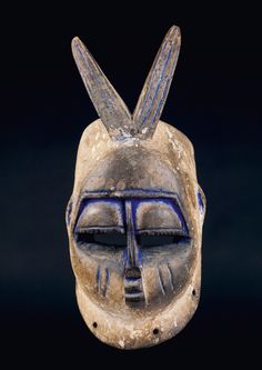 Nigeria. Bini. Zoomorphic mask with scarification marks on the cheeks.