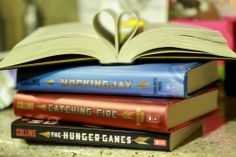 The Hunger Games book series by Suzanne Collins. I was surprised by how quickly I was sucked in!