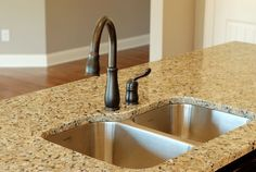 Oil Rubbed Bronze Faucet, Stainless Steel Sink, Granite Top.  www.DACNewHomes.com