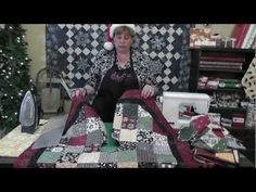 http://missouriquiltco.com -- Our festive Jenny Doan shows us how to make the most adorable little Christmas Tree Skirt!  ***WIN THE SNOW FLAKE QUILT behind Jenny - go to our blog for details at http://blog.missouriquiltco.com/the-best-contest-ever/     To get the materials needed to make this project, visit the links below:    Charm Packs  http...