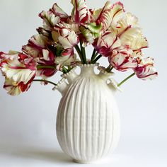 let the flowers speak for themselves in an elegant creamy white vase - designer handmade ceramics