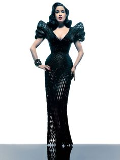 """Dita Von Teese turned more eyes than usual earlier this year, when she wore a Swarovski crystal–encrusted """"mesh"""" black dress, a dramatically netted floor-length piece with elaborate shoulders and a structural frame that hugged all those curves and likely cost into the thousands. It would have made for a great reveal at one of her burlesque performances, but instead she chose it for the final night of a two-day 3-D printing conference hosted by the Ace Hotel in New York."""
