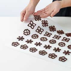 Decorating a gourmet masterpiece has never been easier than with this inventive stencil kit. The included templates make creating elaborate chocolate decorations as simpl. Chocolate Shapes, Chocolate Bomb, Chocolate Art, How To Make Chocolate, Melting Chocolate, Chocolate Designs, Sugar Cookies Recipe, Cake Cookies, Cupcake Cakes