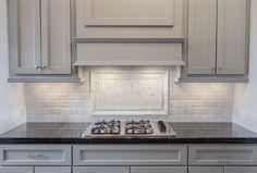 Image result for black granite kitchen countertops gray cabinet