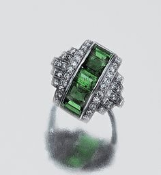 Emerald and diamond ring, circa 1930 - notice the inclusions in the emeralds, a sign that they are genuine.  Many Art Deco and earlier pieces were made with simulated gems to keep the cost down.  Especially sapphire.