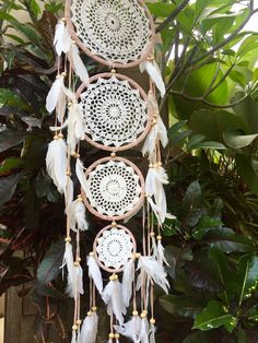 4 Tier crochet dream catcher with white feathers handmade in Indonesia.