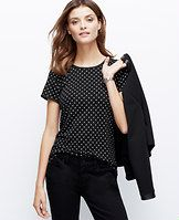 Dotted Back Zip Tee - Popped in a dainty dot print - and detailed with sleek woven trim - this flattering wardrobe staple boasts a simply impeccable fit.�Jewel neck. Short sleeves. Woven trim at neckline, cuffs and back zipper.