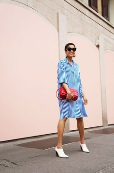 Striped tunic, white heels + statement red clutch