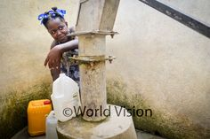 "Amedaka, 11, collecting water at the water station in Londrin. ""I would have to drink water from the river or walk a long distance if this was not put in place,"" testifies the girl. Photo: 2014 Jean-Wickens Merone/World Vision #WaterEffect"