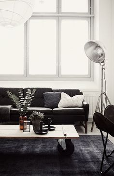 BEAUTIFUL BLACK | the style files | I love how the cushions brighten up the couch a bit