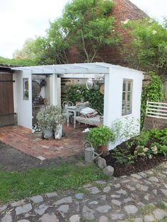"""A nice covered """"outdoor kitchen"""". All you would need to do is add a sliding door to make it weather proof, and you could add a """"sink"""" for the hose to connect to & the grey water could go straight to your garden, & have an extension cord for the outlets you want :) """"princess greeneye"""""""