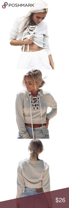 Grey Lace-Up Cropped Sweatshirt Brand new plush grey cropped sweatshirt. Perfect for transitioning into the upcoming colder season. Wear it over a bikini on a cold beach night or by a bonfire with your friends. This piece has the on- trend lace up look. White string can be tied to your liking. Very flattering on everyone ☺️ priced to sell. Bundle for even more savings! Sweaters