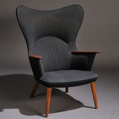 Mama Bear Chair, designed in the 1950's, wool upholstery, teak armrests and walnut frame