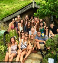 UD Students studying business in Australia/New Zealand pose in front of Hobbiton Movie Set in Matamata, New Zealand. YoUdee came along for trip too! #UDAbroad