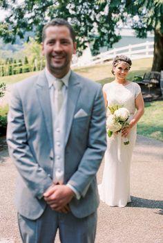 Joyful first look: http://www.stylemepretty.com/2015/01/30/romantic-diy-winery-wedding/ | Photography: Alexandra Knight - http://alexandraknightphotography.com/
