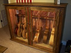 Need something like this for inside the main room of the lodge of our family retreat. Built my own display cabinet. - The Acoustic Guitar Forum Guitar Display Case, Guitar Storage, Guitar Rack, Guitar Stand, Learn Acoustic Guitar, Acoustic Guitars, Guitar Chords, Music Furniture, Guitar Cabinet