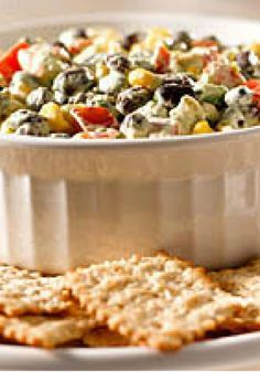 Southwest Avocado Bean Dip -- Nibble on this: avocados, beans, corn and cilantro in a chunky Tex-Mex appetizer recipe. Appetizer Dips, Yummy Appetizers, Appetizers For Party, Appetizer Recipes, Snack Recipes, Cooking Recipes, Snacks, Party Recipes, Yummy Recipes