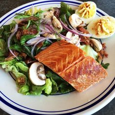 Grilled/Hot smoked salmon - egg Mapley bacon red onion Boston lettuce arugula mushrooms pork belly vinaigrette  #libertykitchenatx #lkatx #salmon #salad  #delicious #atx by libertykitchenatx