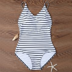 Material: 80% Nylon 20% Spandex Color: White (Stripped) Size Available: Size S: Bust fit 70 AB about 84-90 cm, Waist 68-74 cm; Size M: Bust fit 75 AB about 88-94 cm, Waist 70-76 cm; Size L: Bust fit 80 ABC about 92-100 cm, Waist 72-78 cm; Size XL: Bust fit 85 ABC about 96-104 cm, Waist 74-80 cm;