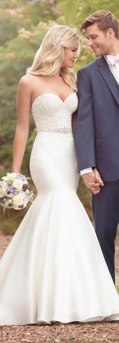 White wedding dress. All brides think of finding the most appropriate wedding day, but for this they require the best bridal gown, with the bridesmaid's outfits actually complimenting the brides-to-be dress. These are a few tips on wedding dresses. #weddinggowns