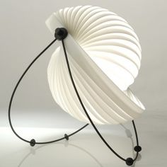 The Eclipse Lamp designed by Mauricio Klabin for Objekto as seen in InsideSeen's winter lighting blog!
