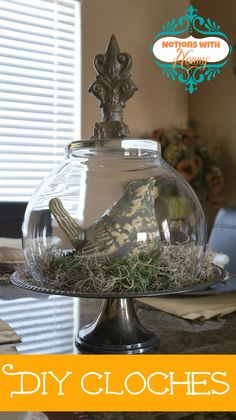 DIY Cloches - thrift store silverplated trays, clear glass vases or bowls, finials from home improvement center.