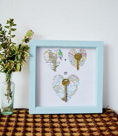 Create a DIY Valentine key framed picture - use old keys and maps to make a unique valentine/wedding gift.