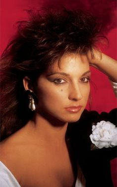 """Gloria Estefan: Then  As the star of the Miami Sound Machine, Estefan became the most successful Latin crossover artist in history during the mid-'80s with a string of hits including """"Rhythm Is Gonna Get You,"""" """"Conga"""" and """"1-2-3.""""-Xfinity Music Programmers"""