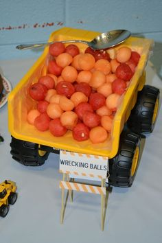 """Another great construction snack! Start with a clean dump truck and serve """"wrecking balls"""" (melon balls) for snack! Serve with some """"wet cement"""" (milk) for a creditable CACFP snack! Serve 1/2 cup melon and 1/2 cup milk to each 1-5 year old for a creditable CACFP snack."""