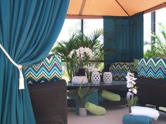Sunbrella outdoor curtain panels can block UV rays, add privacy, keep in the cool or warmth, and add pops of color to your outdoor space!