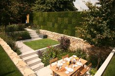 small gardens | ... of heathers fill the greenwall at the back of this sunken garden