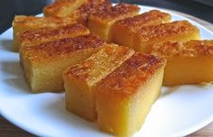 Traditional cassava (tapioca) cake is soft, chewy and fragrant. It has an inviting aroma from the screw pine leaves (pandan leaves), eggs and coconut milk. Just perfect for tea-time snack or as dessert. eggs, lightly beaten, 220 g sugar¼ tsp . Filipino Desserts, Asian Desserts, Chinese Desserts, Filipino Food, Casava Cake Recipe, Cassava Pone, Tapioca Cake, Fijian Food, Tongan Food
