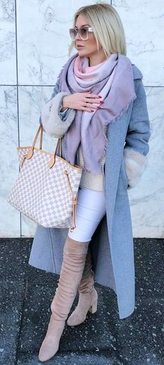 #spring #outfits  woman wearing grey cardigan while walking during daytime. Pic by @mirabelove