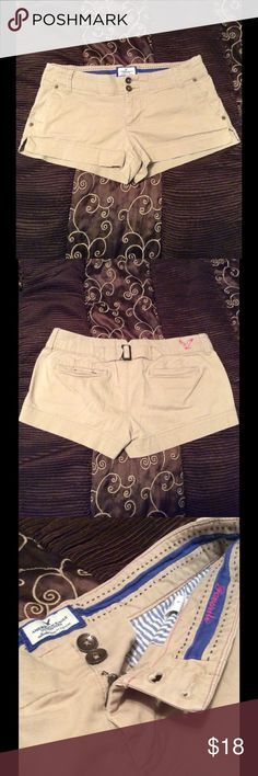 American Eagle Shorts Size 6 American Eagle Outfitters Brand... Size 6 Creamy Tan in color! I Love the cute Buckle on the back with the hot pink Eagle!!!!!! Very Cute shorts! In like New condition! Worn only once! Made of 98% Cotton 2% Spandex. If you have any questions feel free to ask. ❤️Thank you for taking the time to stop by and check out my closet! Leave your name below and I check  out your closet as well! 😁👍 American Eagle Outfitters Shorts
